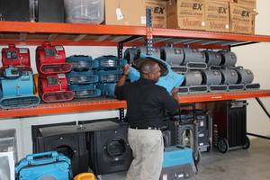 Water Damage Homewood Technician Mobilizing Air Movers