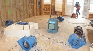 Air Movers and Dehumidifiers Drying Out Water Damaged Room